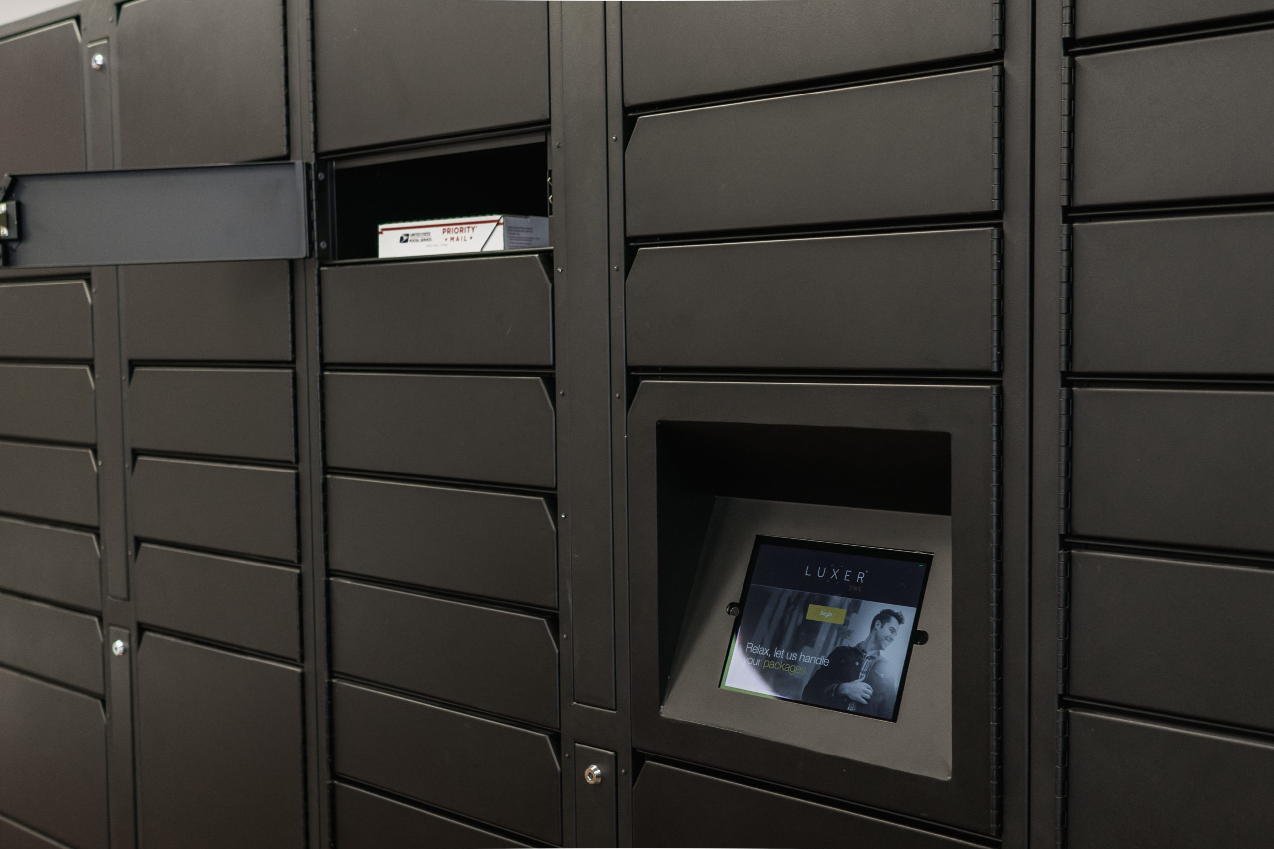 Luxer Parcel Locers LCD and Opened Locker