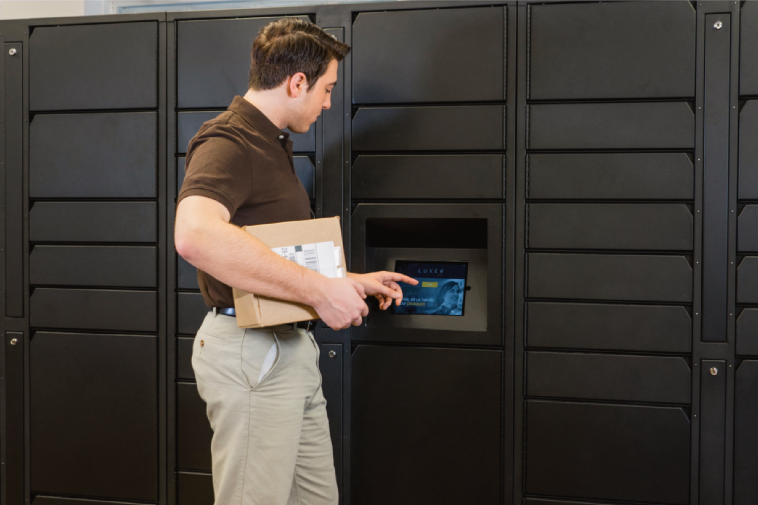 Carrier Dropping off Package in Luxer One Parcel Locker